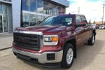 This Red 4 door SLE Pickup features  a 6 Spd Automatic transmission, a  5.3L  V 8 engine, and has 85882 kilometres on it.